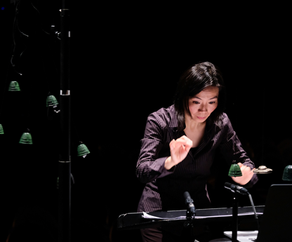 Conductor Lin Liao plays virtual instrument